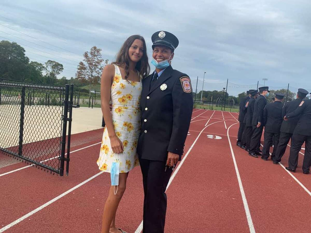 Chaja Pole-Feenstra was one of 27 new firefighters sworn in by Bridgeport Mayor Joseph Ganim during a ceremony Wednesday on the John Lewis Memorial Field at Harding High School