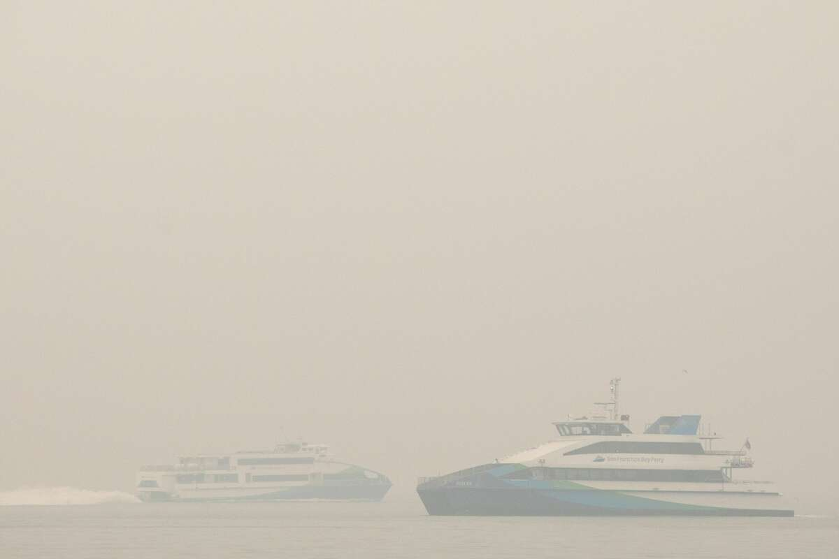 Two ferries pass on San Francisco Bay under smoky skies on Sept. 10, 2020.