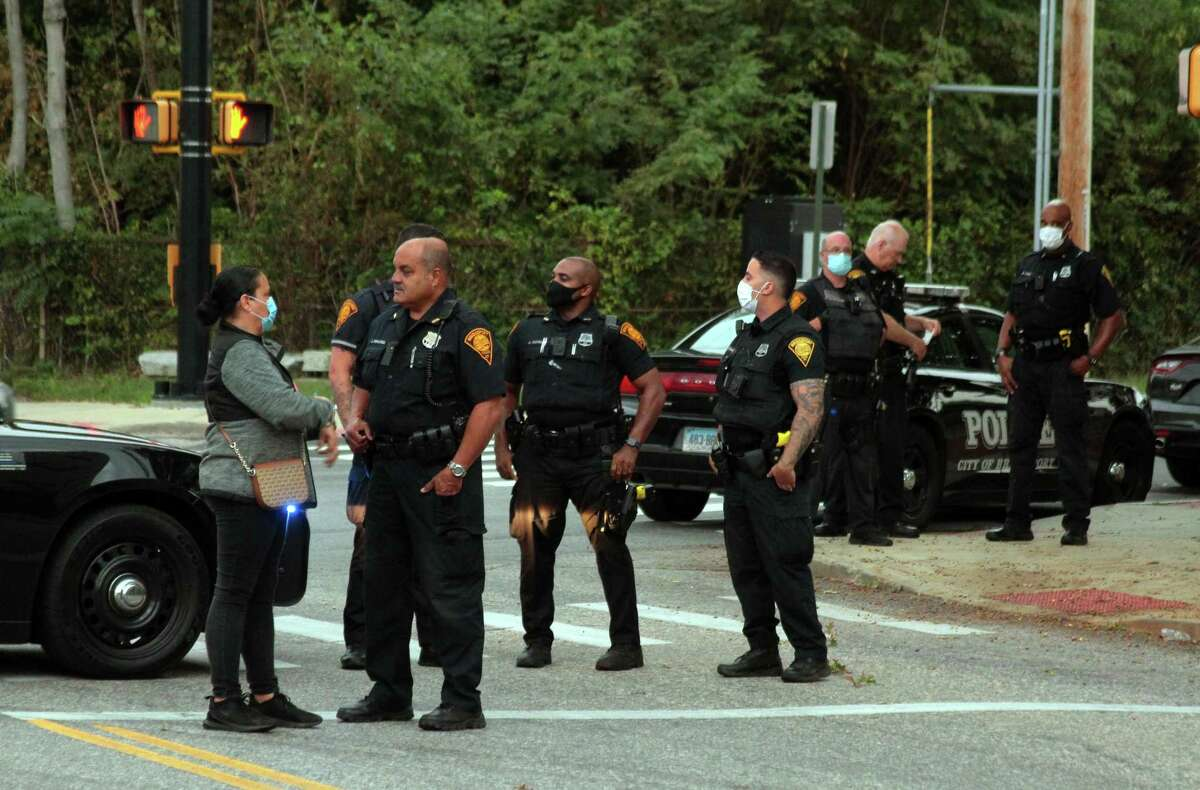 Bridgeport police congregate on James Street at the start of a protest in front of police headquarters in Bridgeport, Conn., on Thursday Sept. 10, 2020. Friends and family of police shooting victim Jayson Negron came out after the arrest of police chief AJ Perez earlier in the day.