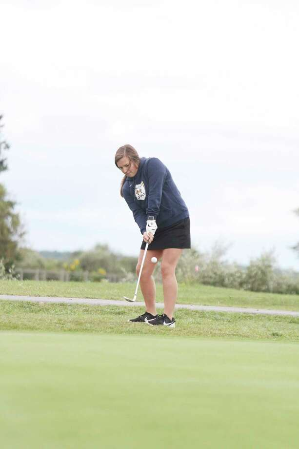 Manistee's Sara Danison chips on to No. 3 on Thursday at Manistee Golf & Country Club. (Dylan Savela/News Advocate)
