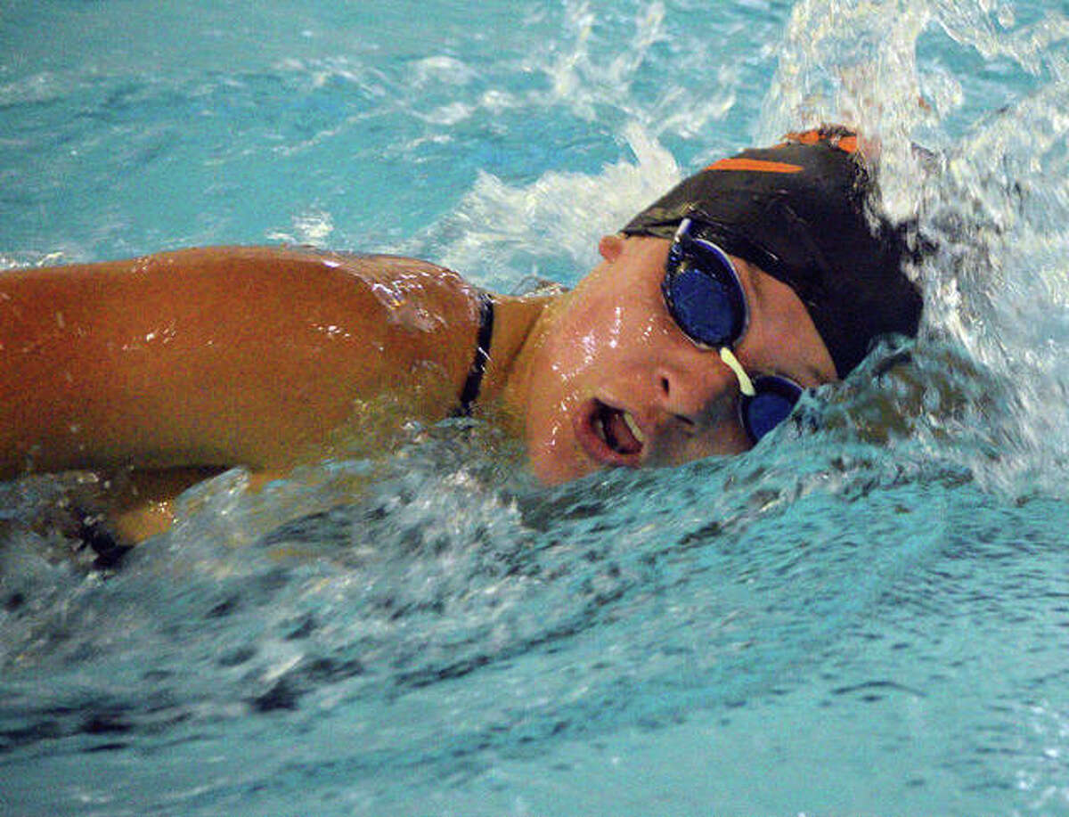 Edwardsville's Jordan Mercer competes in the 200-yard freestyle during Thursday's season-opening dual meet against O'Fallon at Chuck Fruit Aquatic Center. Web gallery for EHS-O'Fallon swimming