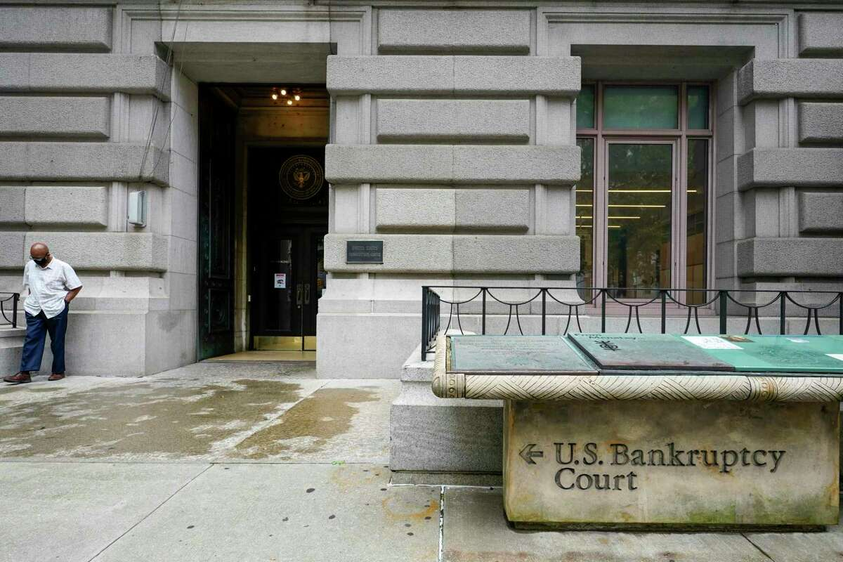 A man walks away from the U.S. Bankruptcy court in lower Manhattan, Thursday, Sept. 10, 2020. Stocks gave up an early gain and moved steadily lower all day, erasing nearly all of a rally from a day earlier and extending their losses for the week. (AP Photo/Mary Altaffer)
