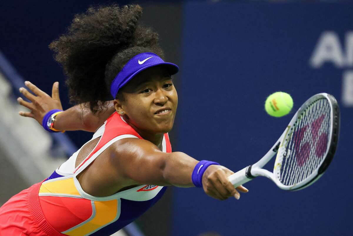 NEW YORK, NEW YORK - SEPTEMBER 10: Naomi Osaka of Japan returns the ball during her Women's Singles semifinal match against Jennifer Brady of the United States on Day Eleven of the 2020 US Open at the USTA Billie Jean King National Tennis Center on September 10, 2020 in the Queens borough of New York City. (Photo by Al Bello/Getty Images)