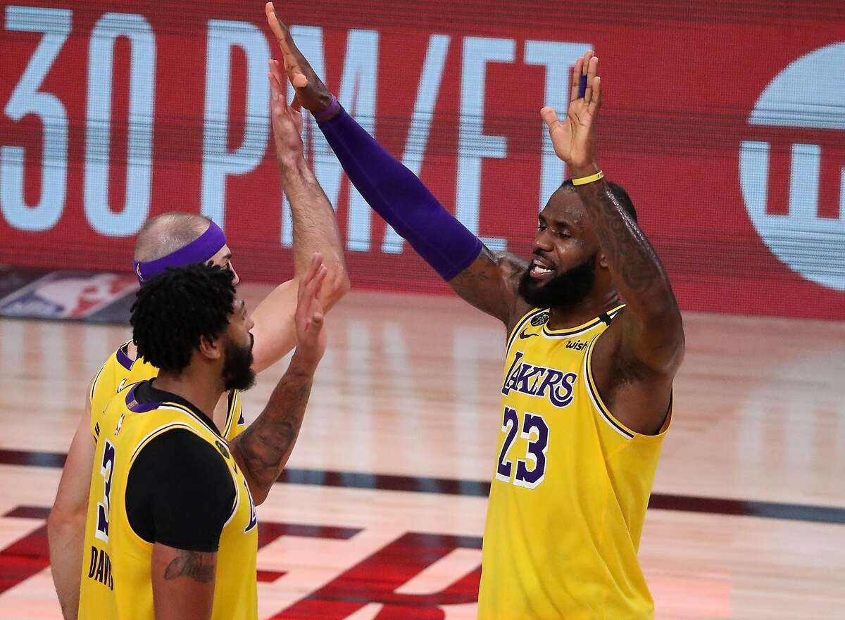 LAKE BUENA VISTA, FLORIDA - SEPTEMBER 10: LeBron James #23 of the Los Angeles Lakers reacts with Anthony Davis #3 of the Los Angeles Lakers during the fourth quarter against the Houston Rockets in Game Four of the Western Conference Second Round during the 2020 NBA Playoffs at AdventHealth Arena at the ESPN Wide World Of Sports Complex on September 10, 2020 in Lake Buena Vista, Florida. NOTE TO USER: User expressly acknowledges and agrees that, by downloading and or using this photograph, User is consenting to the terms and conditions of the Getty Images License Agreement. (Photo by Michael Reaves/Getty Images)