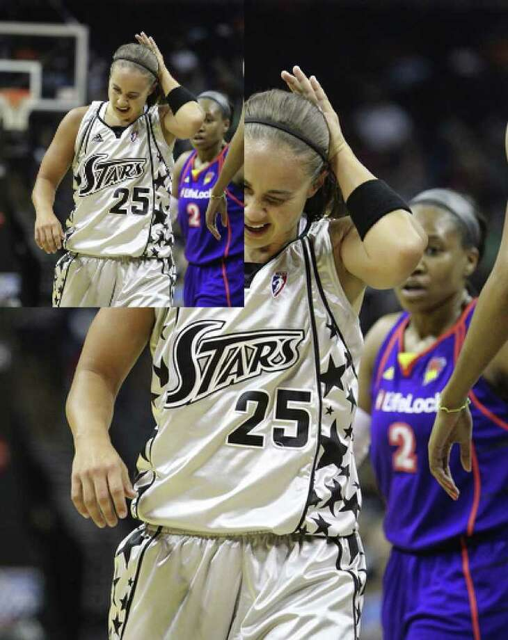 Silver Stars' Becky Hammon winces after colliding with a Phoenix Mercury player in Game 2 of the Western Conference semifinals at the AT&T Center on Saturday, August 28, 2010. Kin Man Hui/kmhui@express-news.net