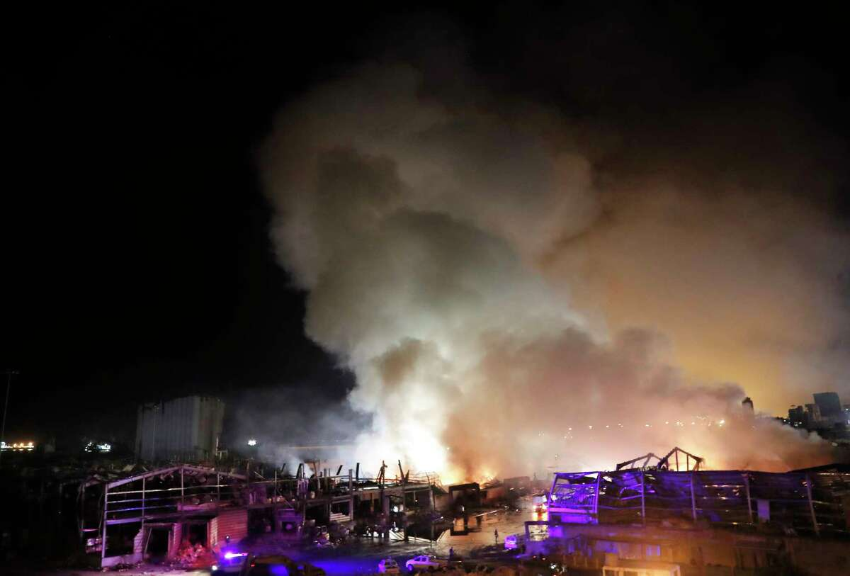 Flames and smoke rise from burning warehouses at the seaport of Beirut, Lebanon, Thursday, Sept. 10. 2020. A huge fire broke out Thursday at the Port of Beirut, triggering panic among residents traumatized by last month's massive explosion that killed and injured thousands of people. (AP Photo/Hussein Malla)