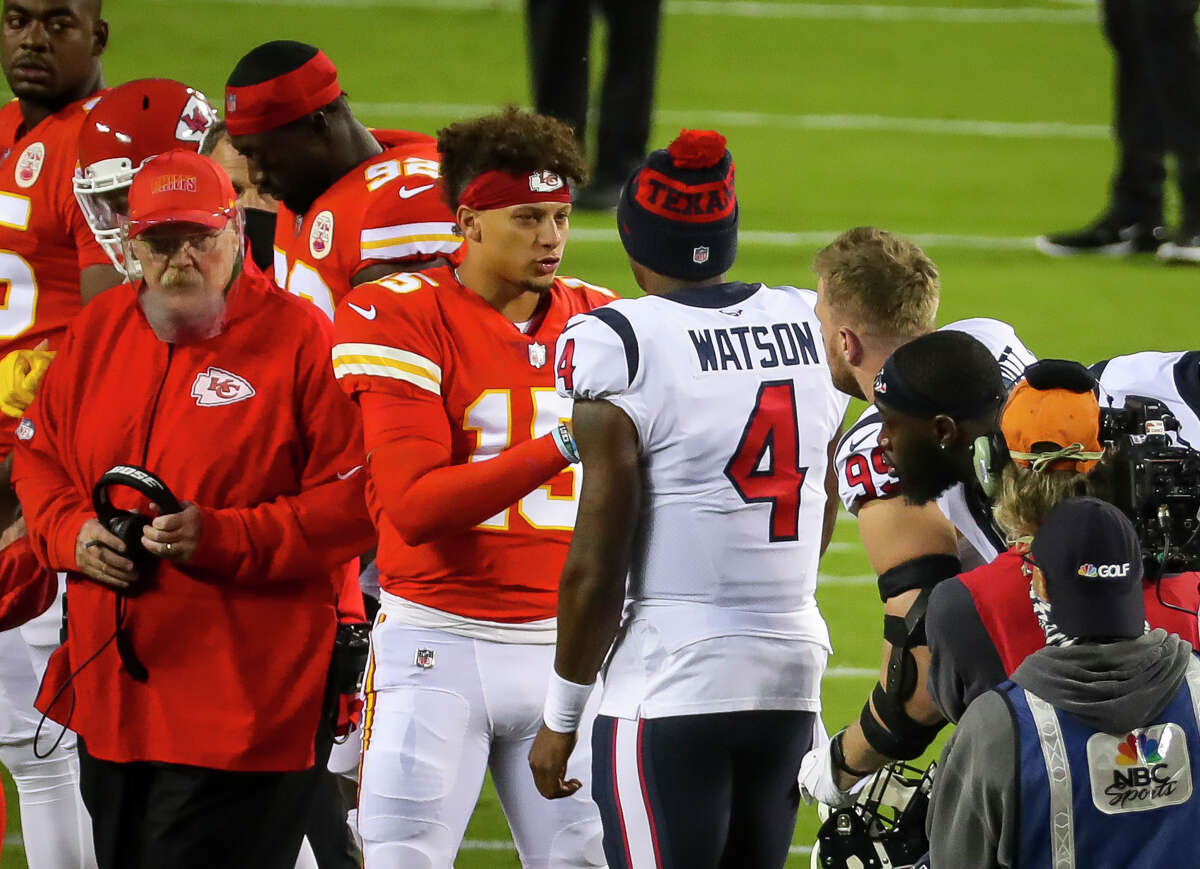 Kansas City Chiefs quarterback Patrick Mahomes (15) and Houston Texans quarterback Deshaun Watson (4) meet at midfield before the start of an NFL football game on Thursday, Sept. 10, 2020, at Arrowhead Stadium in Kansas City.