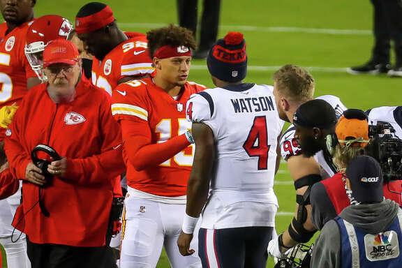 Kansas City Chiefs quarterback Patrick Mahomes (15) and Houston Texans quarterback Deshaun Watson (4) meet at midfield before the start of an NFL football game on Thursday, Sept. 10, 2020, at Arrowhead Stadium in Kansas City.