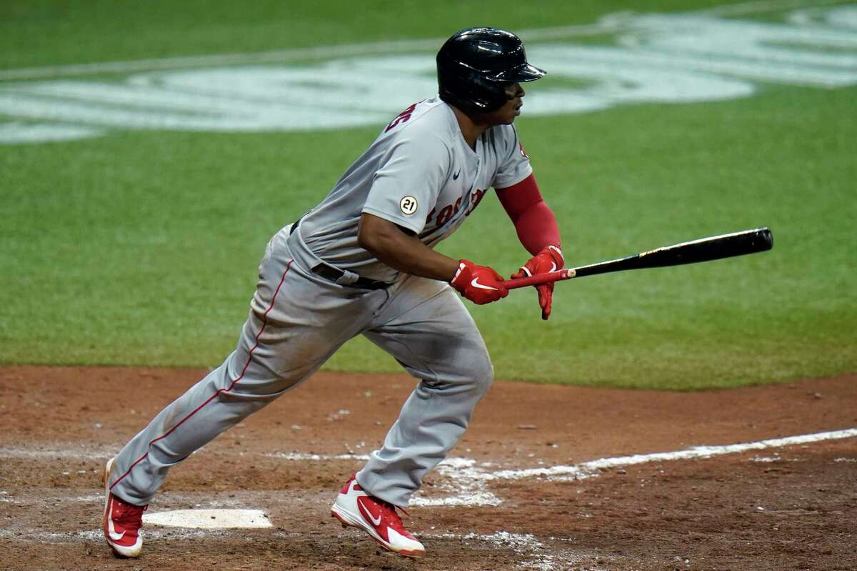 Boston Red Sox's Rafael Devers lines an RBI single off Tampa Bay Rays relief pitcher Peter Fairbanks during the seventh inning of a baseball game Thursday, Sept. 10, 2020, in St. Petersburg, Fla. Boston's Christian Arroyo scored on the hit. (AP Photo/Chris O'Meara)