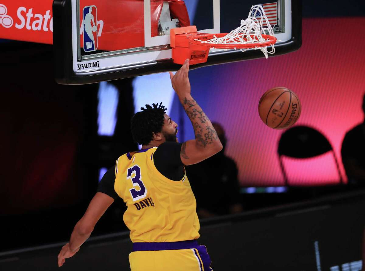 LAKE BUENA VISTA, FLORIDA - SEPTEMBER 10: Anthony Davis #3 of the Los Angeles Lakers dunks the ball during the third quarter against the Houston Rockets in Game Four of the Western Conference Second Round during the 2020 NBA Playoffs at AdventHealth Arena at the ESPN Wide World Of Sports Complex on September 10, 2020 in Lake Buena Vista, Florida. NOTE TO USER: User expressly acknowledges and agrees that, by downloading and or using this photograph, User is consenting to the terms and conditions of the Getty Images License Agreement. (Photo by Michael Reaves/Getty Images)