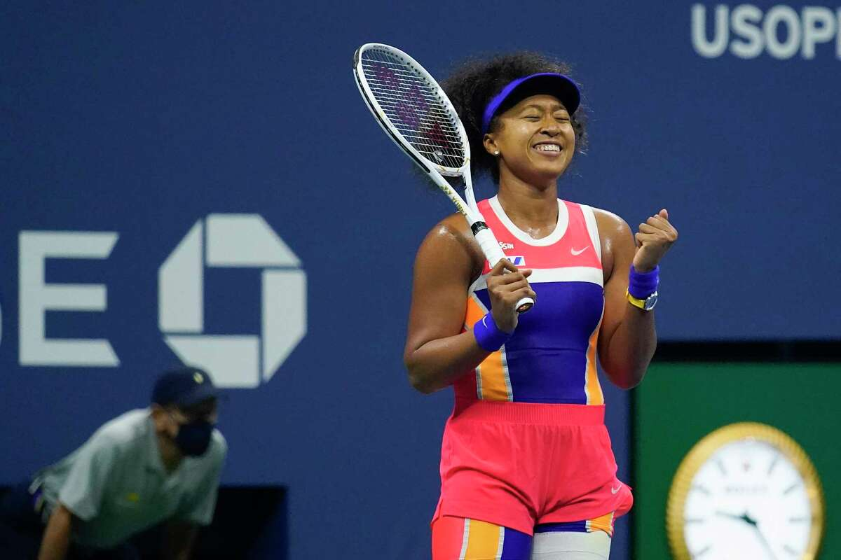 Naomi Osaka, of Japan, reacts after defeating Jennifer Brady, of the United States, during a semifinal match of the US Open tennis championships, Thursday, Sept. 10, 2020, in New York. (AP Photo/Seth Wenig)