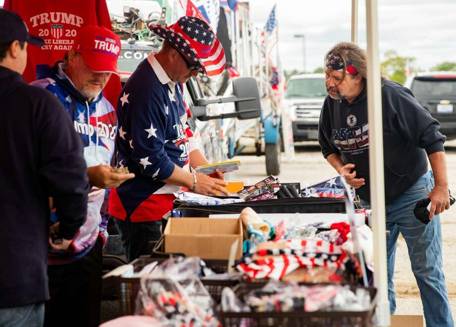 Venders sell merchandise outside of President Donald Trump's campaign rally at MBS International Airport on Thursday, Sept. 10, 2020 in Freeland. (Daytona Niles/for the Daily News) Photo: (Daytona Niles/for The Daily News) / Daytona Lee Photography LLC