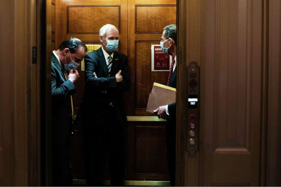 From left: Sens. Mike Lee (R-Utah), Ron Johnson (R-Wis.), and John Barrasso (R-Wyo.), ride on an elevator after a series of votes at the Capitol in Washington, Thursday, Sept. 10, 2020. Senate Republicans on Thursday failed to advance their substantially scaled-back stimulus plan amid opposition by Democrats who called the measure inadequate. (Anna Moneymaker/The New York Times) Photo: ANNA MONEYMAKER, STR / NYT / NYTNS