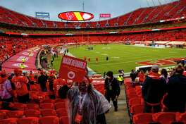 An usher reminds fans of the rules while they find their seats before an NFL football game on Thursday, Sept. 10, 2020, at Arrowhead Stadium in Kansas City.