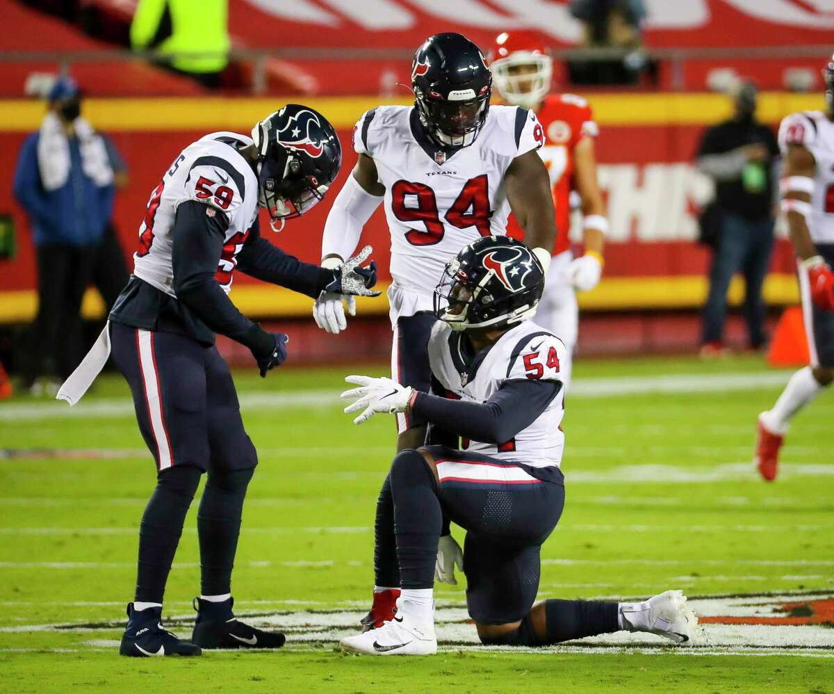 Houston Texans linebacker Jacob Martin (54) celebrates his sack of Kansas City Chiefs quarterback Patrick Mahomes (15) with linebacker Whitney Mercilus (59) and defensive end Charles Omenihu (94) during the first quarter of an NFL football game on Thursday, Sept. 10, 2020, at Arrowhead Stadium in Kansas City.