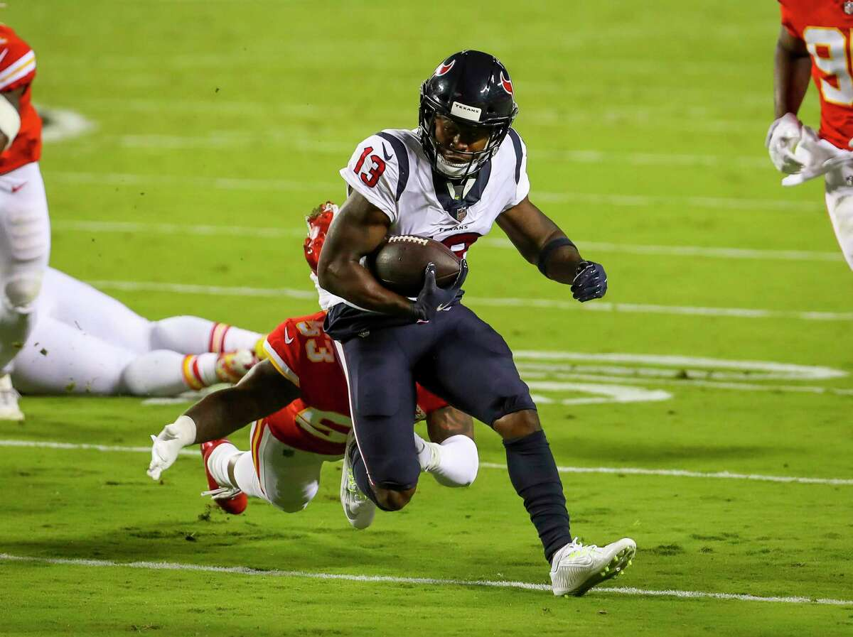 Houston Texans wide receiver Brandin Cooks (13) runs from Kansas City Chiefs linebacker Anthony Hitchens (53) during the first quarter of an NFL football game on Thursday, Sept. 10, 2020, at Arrowhead Stadium in Kansas City.