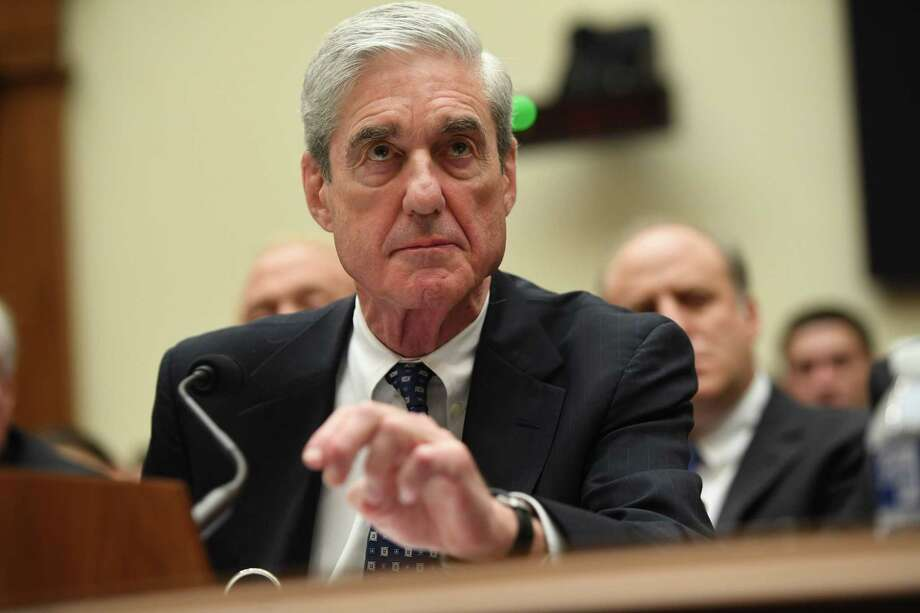 (FILES) In this file photo taken on July 24, 2019 former Special Prosecutor Robert Mueller testifies before Congress in Washington, DC. - Donald Trump may have commuted Roger Stone's prison sentence but the president's longtime ally remains a convicted criminal, former special counsel Robert Mueller said on July 11, 2020. (Photo by SAUL LOEB / AFP) (Photo by SAUL LOEB/AFP via Getty Images) Photo: SAUL LOEB, Contributor / AFP Via Getty Images / AFP or licensors