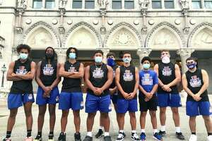 "Members of the Danbury High School football team participated in a rally for a football season a the state Capitol on Wednesday, Sept. 9, 2020. Third from left is Brenyn Boswell, who said, ""I wish they would at least give us a definite 'No.'"""
