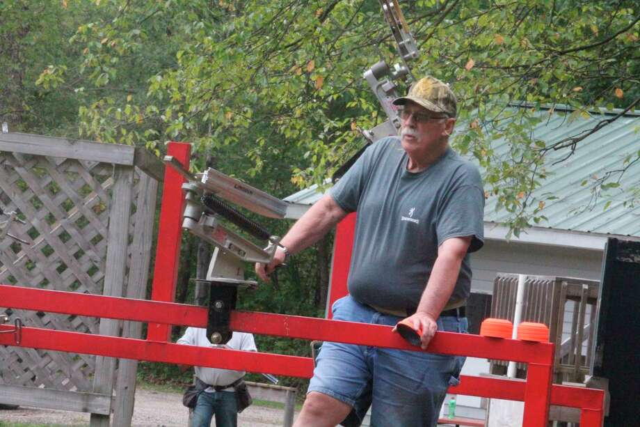 Mecosta County Rod & Gun Club president Randy Rice gets ready to release sporting clays targets on Saturday. (Pioneer photo/John Raffel)