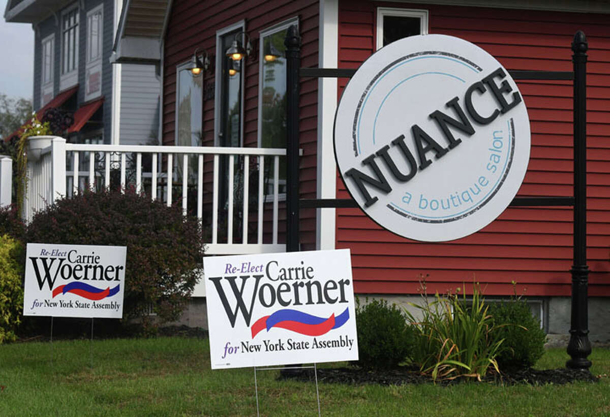Campaign signs for Assemblywoman Carrie Woerner are posted outside Nuance A Boutique Salon on Thursday, Sept. 10, 2020, in Malta, N.Y. The salon is owned by a co-founder of the New York State Association of Salon and Spa Professionals, and mother of a Woerner staff member. Assemblywoman Carrie Woerner has introduced several bills pushed by the salon trade group, including a controversial one requiring