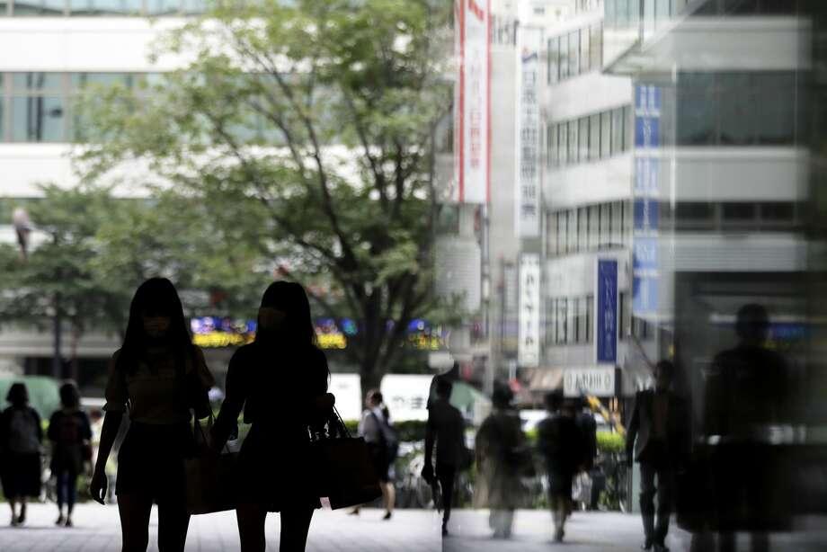 Pedestrians walk along a street in Tokyo, Japan, on Tuesday, July 9, 2019. Photographer: Kiyoshi Ota/Bloomberg Photo: Kiyoshi Ota/Bloomberg / ? 2019 Bloomberg Finance LP
