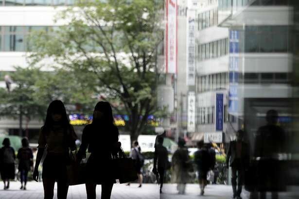 Pedestrians walk along a street in Tokyo, Japan, on Tuesday, July 9, 2019. Photographer: Kiyoshi Ota/Bloomberg