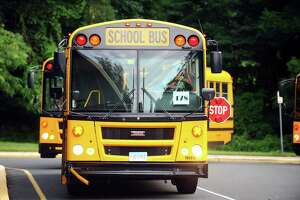 School buses pull into Stillmeadow Elementary School while practicing their routes the day before school starts in Stamford, Conn. on Wednesday, August 30, 2017.