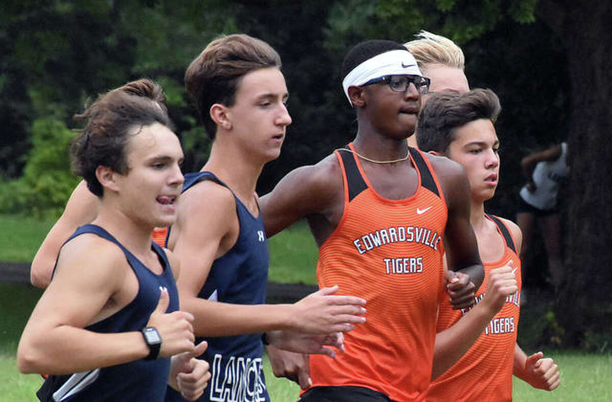 Edwardsville senior Brandon Battle, third from left, runs in a pack in a dual meet against Belleville East at the Clinton Hills Conservation Park in Swansea.