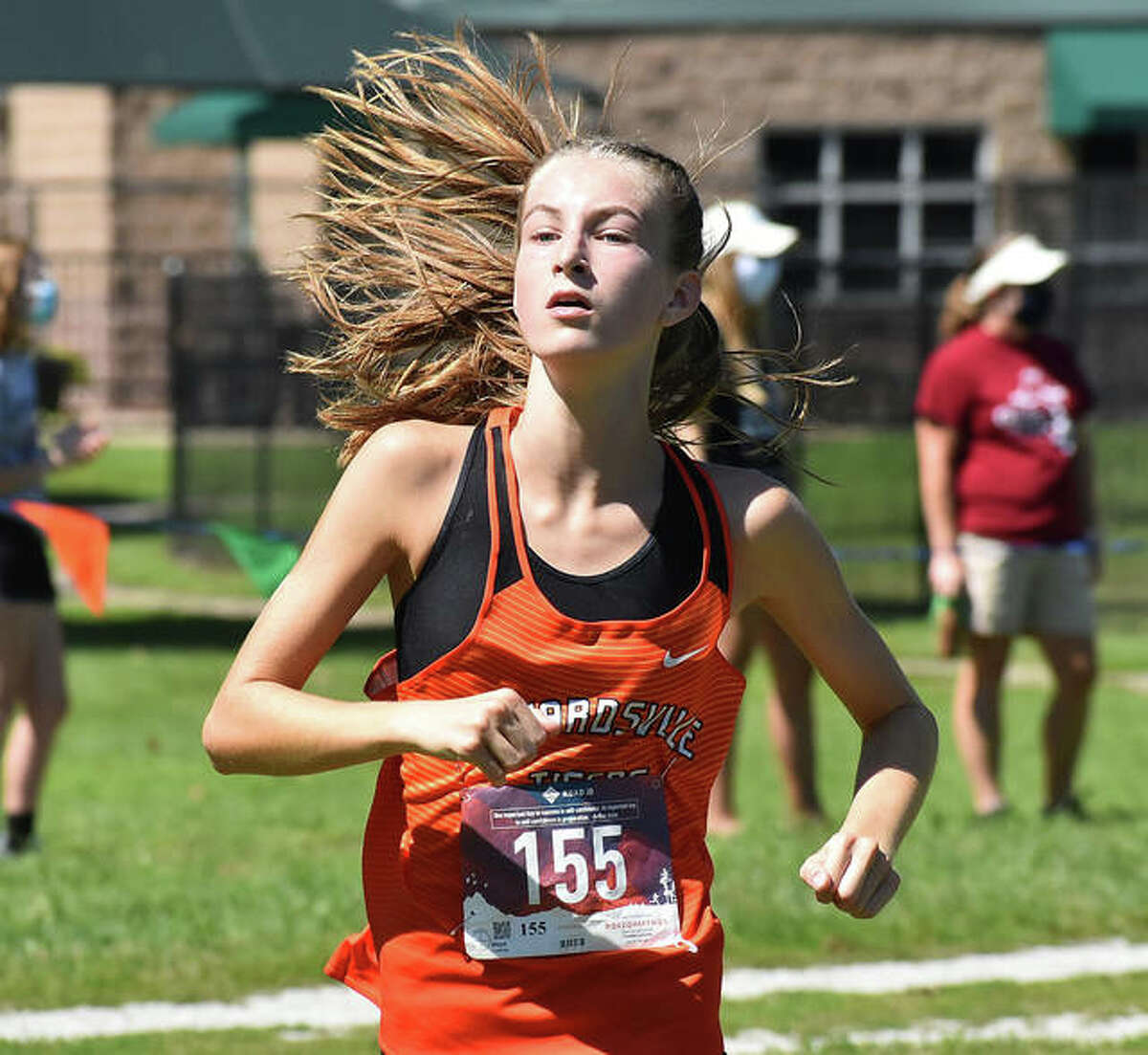 Edwardsville's Maya Lueking nears the finish line of the Granite City Invitational.