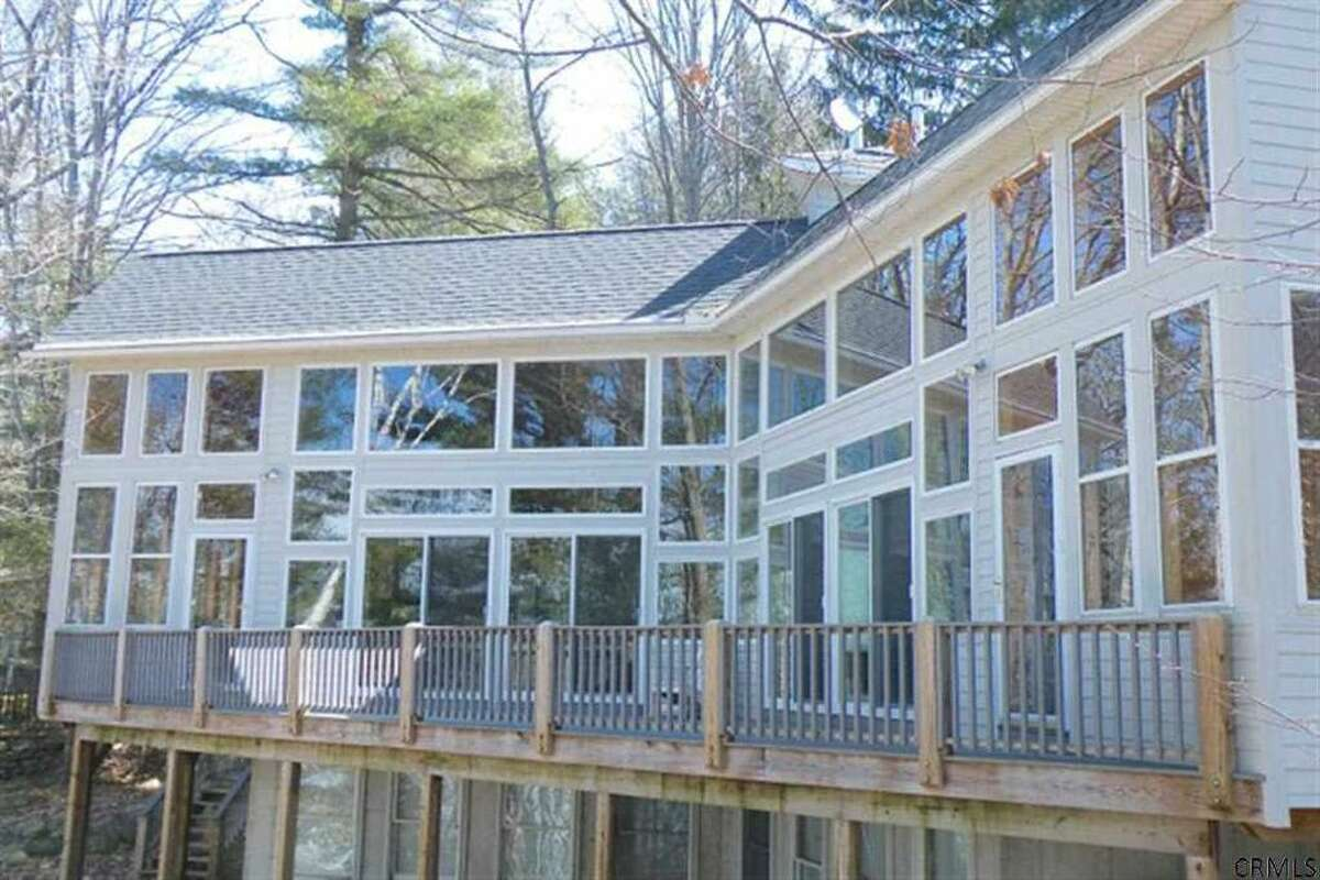 Michael Mann's house on Great Sacandaga Lake could fetch $550,000 or more at sale. Mann has been granted permission by a federal judge to sell the house.