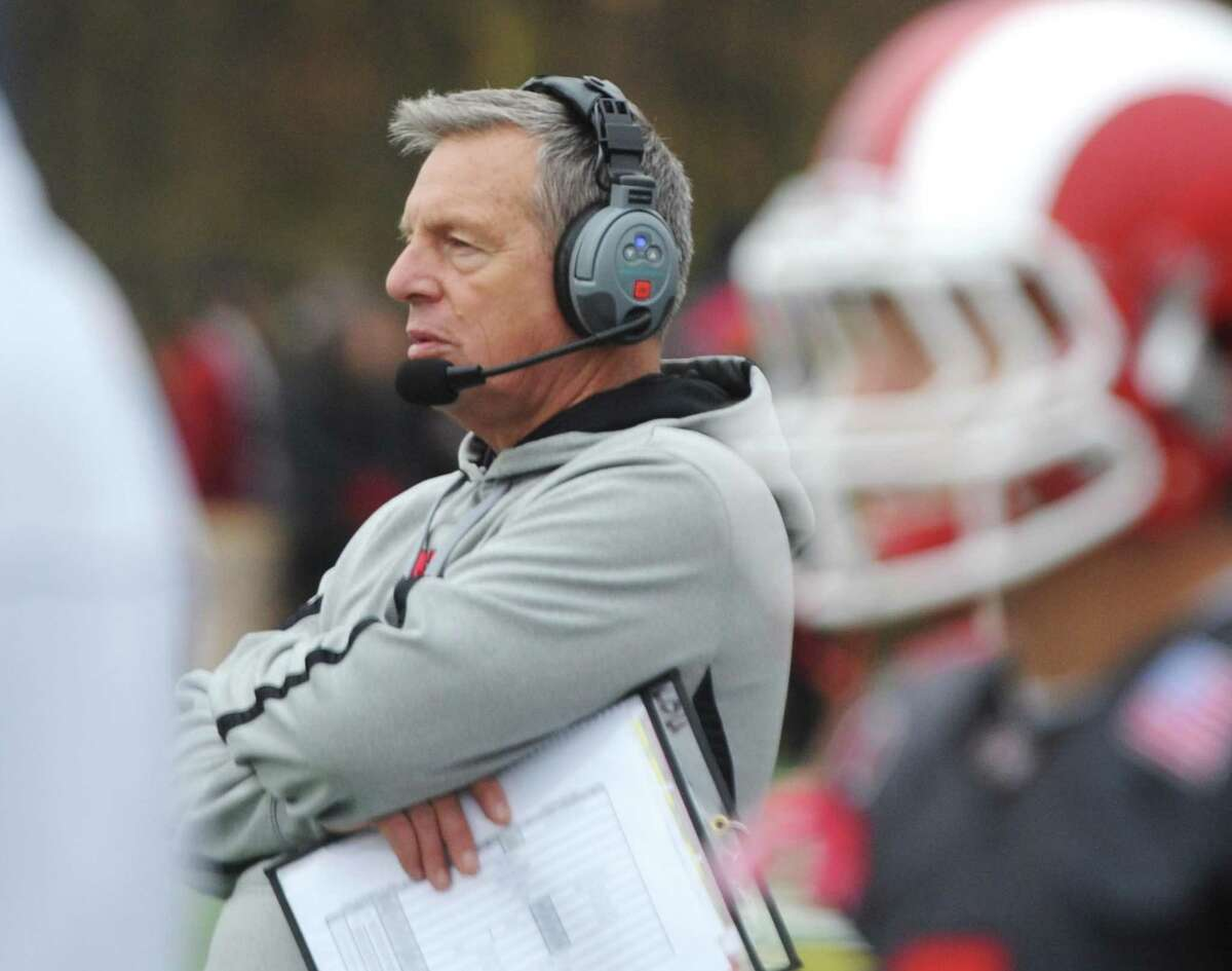 New Canaan head coach Lou Marinelli watches on the sidelines during Darien's 37-34 win over New Canaan in the Turkey Bowl high school football game at Dunning Stadium in New Canaan, Conn. Thursday, Nov. 24, 2016. New Canaan scored 24 unanswered points to tie the game and force an overtime. In overtime, Darien kicked a field goal to take the lead and forced a New Canaan interception to end the game, setting off a wild celebration as fans stormed the field.