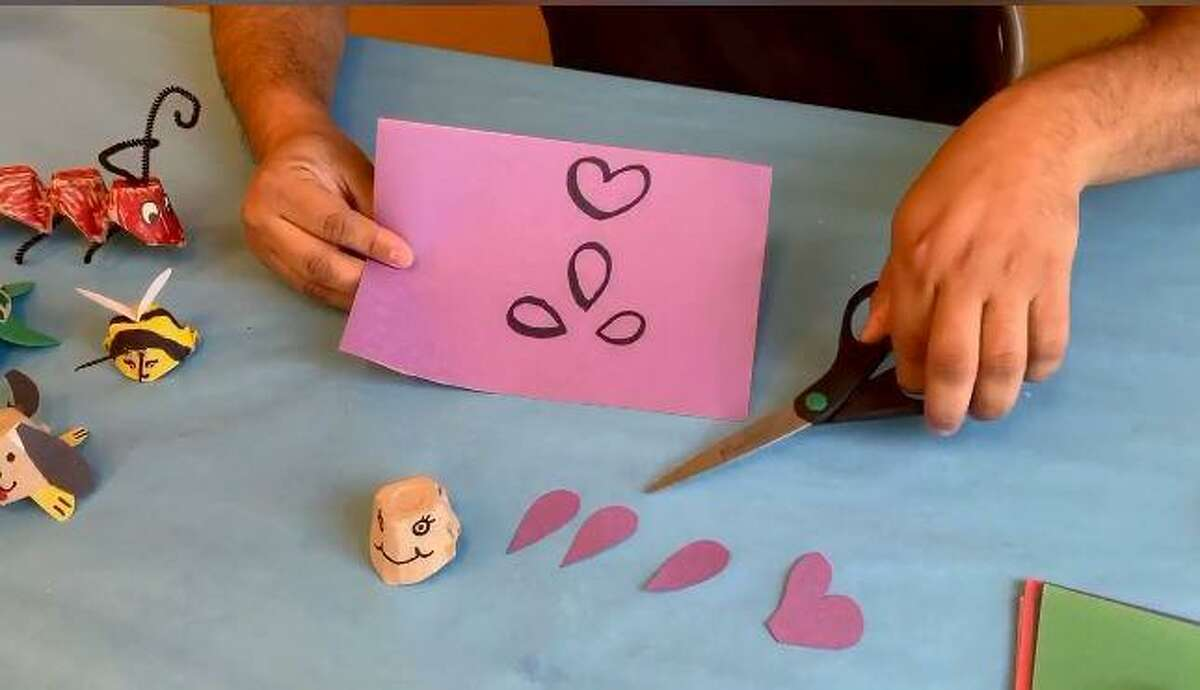 Using markers, draw three tear-shaped fins and a heart-shaped tail on construction paper. When they are to your liking, tape or glue them to the fish's body.