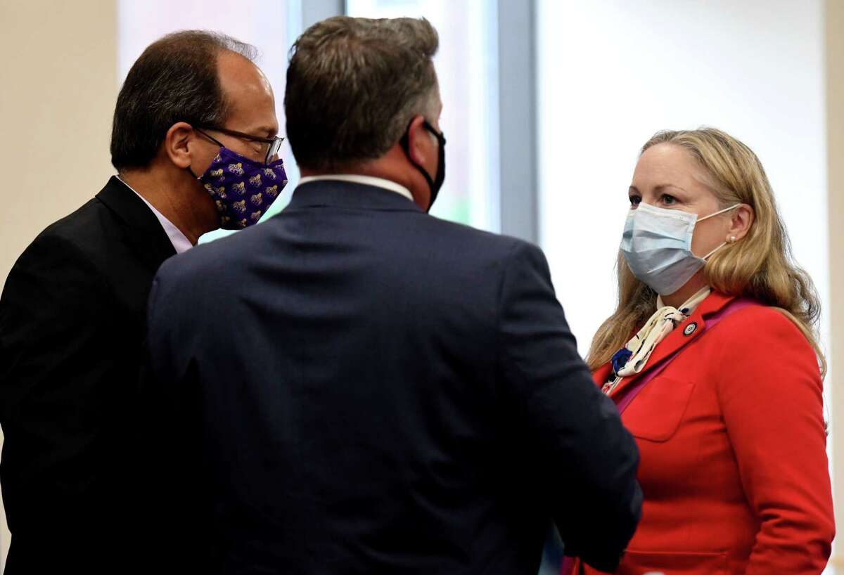 Albany County Executive Dan McCoy, left, University at Albany President Havidan Rodriguez, center, and Albany County Department of Health Commissioner Dr. Elizabeth Whalen, right, talk following a county coronavirus news briefing on Friday, Sept. 11, 2020, at the county offices in Albany, N.Y. Albany County saw its largest growth in coronavirus cases in a month, with a spike of COIVID-19 infections at the UAlbany campus. (Will Waldron/Times Union)