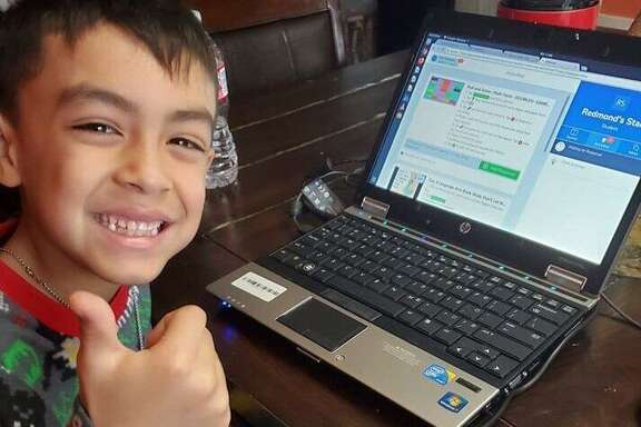 A Houston area students who benefited from Comp-U-Dopt's Computer Lottery