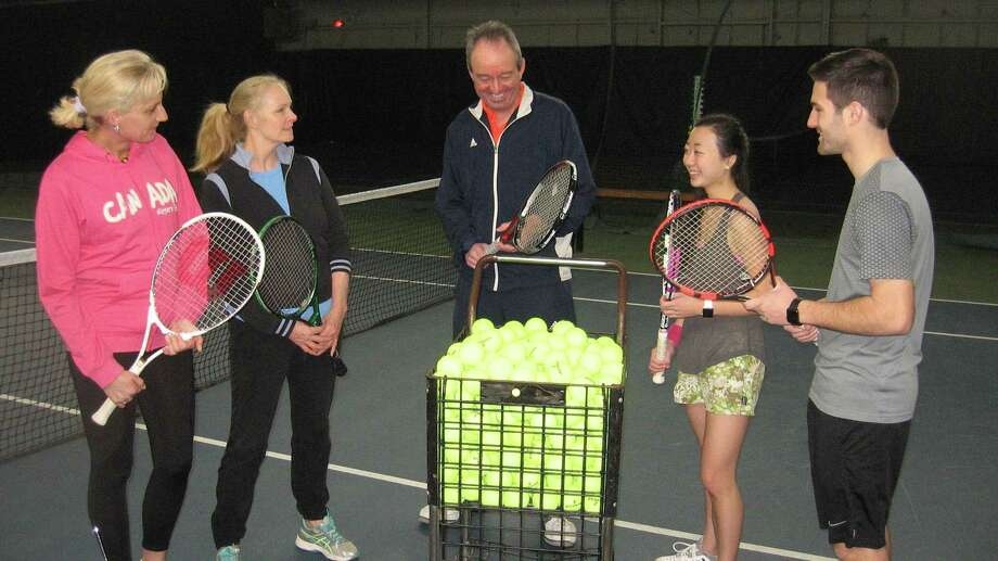 Pinewoods owner Bob Cofer joins students at the tennis club, which recently reopened. Photo: John Torsiello / Contributed Photo /