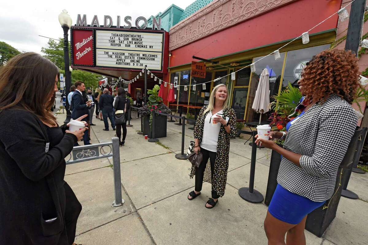 From left, Brianna Huynh of Latham, Holly Garcia of Rotterdam and Carla George of Watervliet enjoy coffee as they wait in line to audition for the reality show