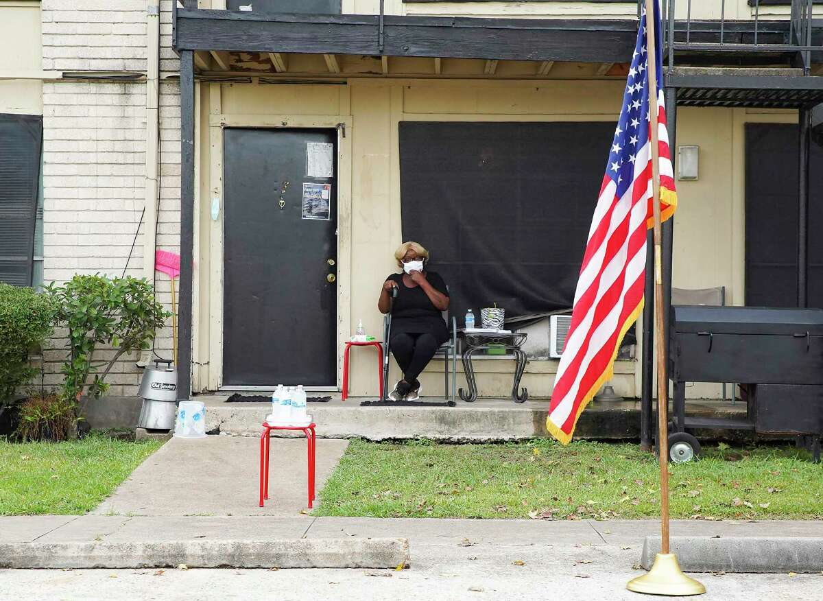 Judy Phillips, waits outside her apartment for a press conference with U.S. Rep. Sheila Jackson Lee at Spanish Village Apartments in Houston on Tuesday, Sept. 8, 2020. Phillips, who has cancer, was scheduled to be evicted today, but was able to stay with the help of Rep. Jackson Lee.