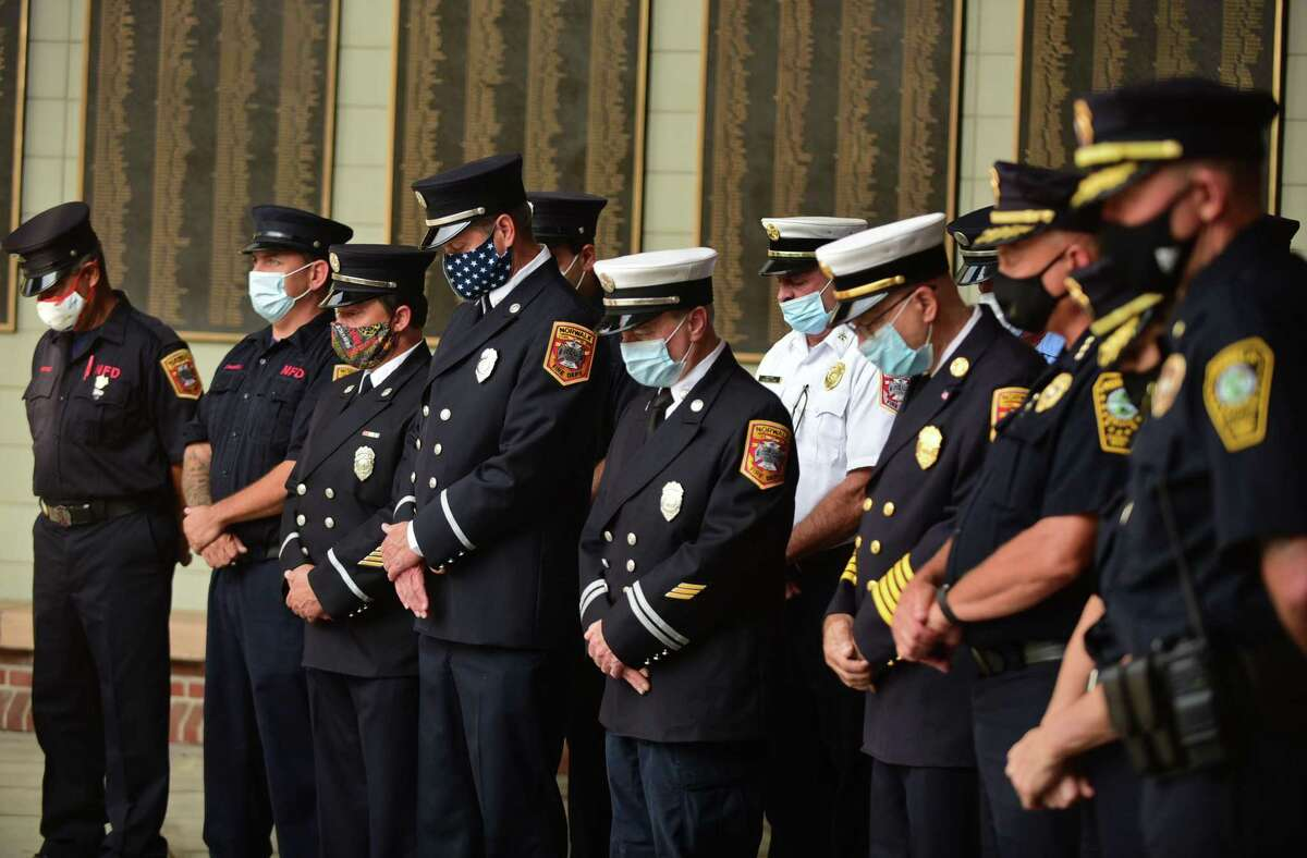 The City of Norwalk holds its annual 9/11 Remembrance Ceremony outside of City Hall Friday, September 11, 2020, in Norwalk, Conn. The mayor led the ceremony with members of the police and fire departments in attendance.