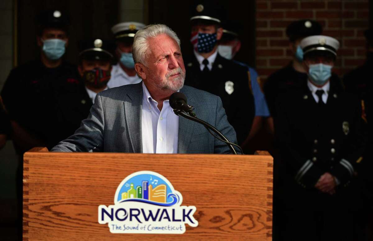 Norwalk mayor Harry Rilling gives his opening remarks as the City of Norwalk holds its annual 9/11 Remembrance Ceremony outside of City Hall Friday, September 11, 2020, in Norwalk, Conn. The mayor led the ceremony with members of the police and fire departments in attendance.