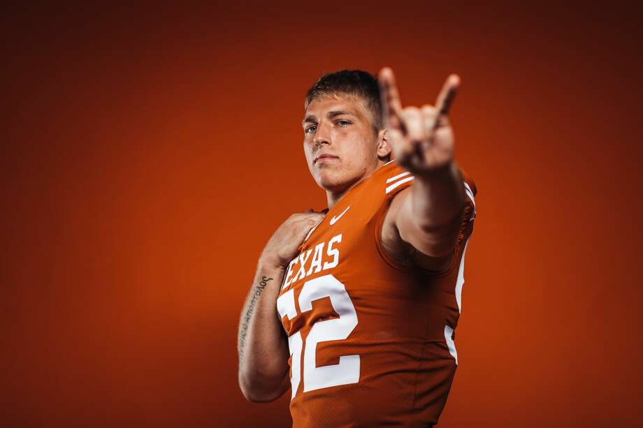It was that defining moment when all the hard-fought games, grueling workouts, strenuous practices, the disappointments on the field paid off. University of Texas sophomore linebacker and Houston native Jett Bush landed a full football scholarship after starting out in 2019 as a walk-on. It was all captured on a video this week that's now gone viral on Twitter. Photo: Matt Lange/Texas Athletics