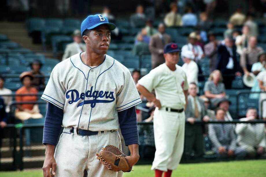 """Chadwick Boseman as Jackie Robinson in a scene from """"42."""" Photo: D. Stevens / Associated Press / A2012"""