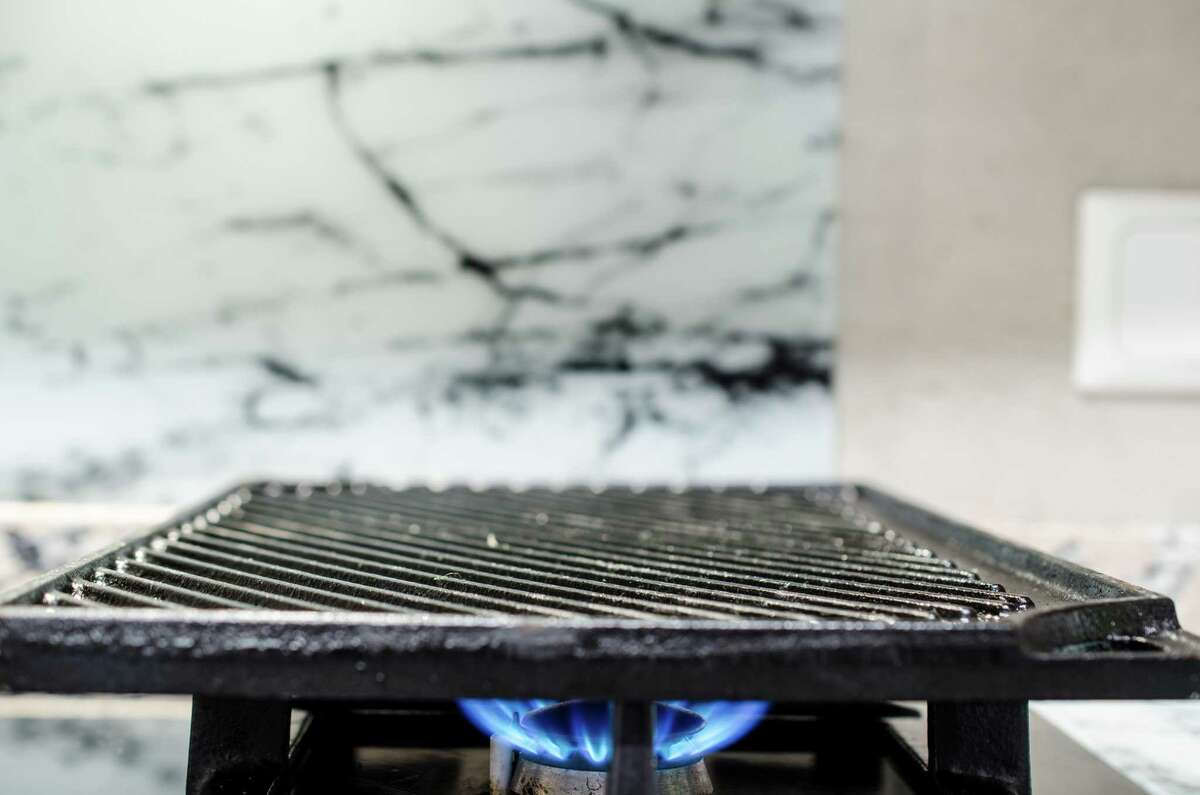 A reversible cast-iron griddle with flat and ridged sides is perfect for pancakes or searing a steak.