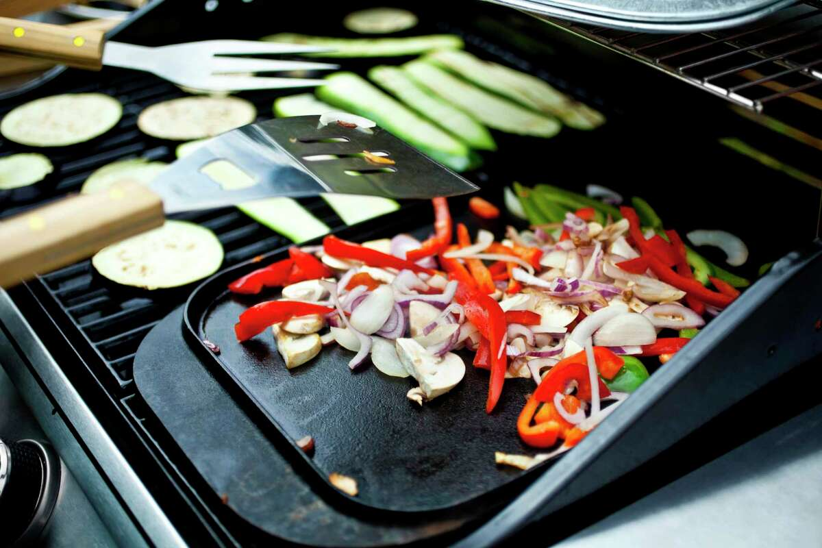 A cast-iron griddle can help prevent small things from falling through the grates on a grill.