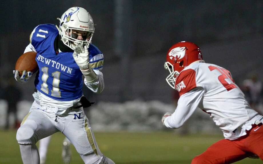 Newtown's Miles Ricks (11) goes around NFA's Nathan Cote (24) in the Class LL State Football Quarterfinal game between No.8 Norwich Free Academy and No. 1 Newtown high schools, Wednesday December 4, 2019, at Newtown High School, Newtown, Conn. Photo: H John Voorhees III / Hearst Connecticut Media / The News-Times