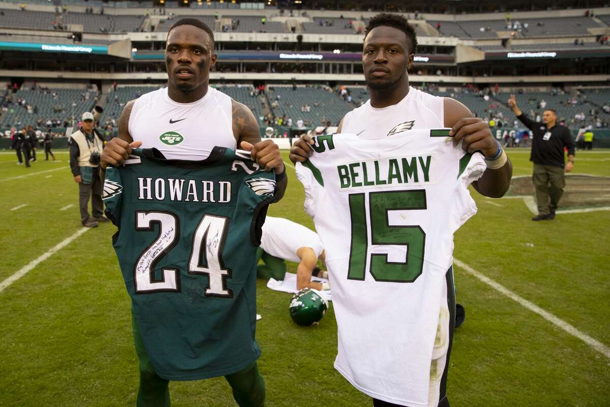 Josh Bellamy #15 of the New York Jets and Jordan Howard #24 of the Philadelphia Eagles pose for a picture after a jersey swap at Lincoln Financial Field on October 6, 2019 in Philadelphia, Pennsylvania.