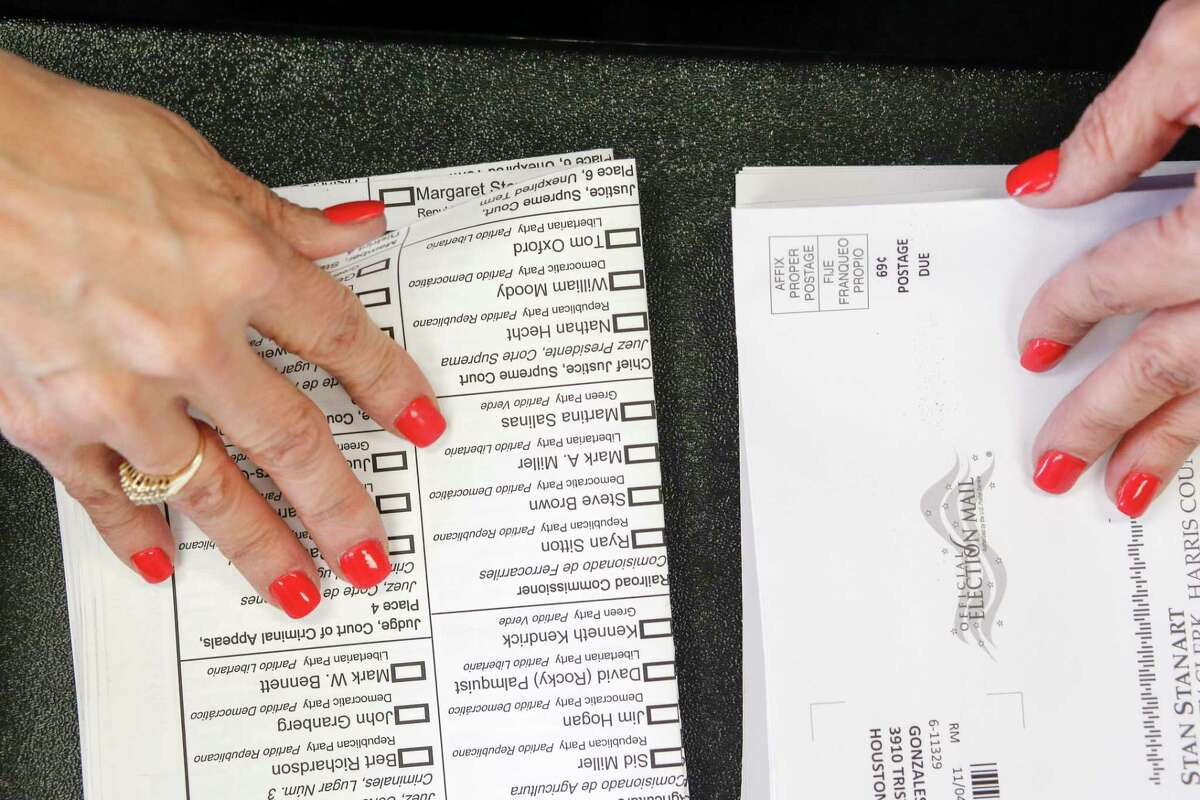 Election clerk Sonia Salinas works to fulfill requests for ballots by mail, Friday, Sept. 19, 2014 in Houston. (Eric Kayne/For the Chronicle)