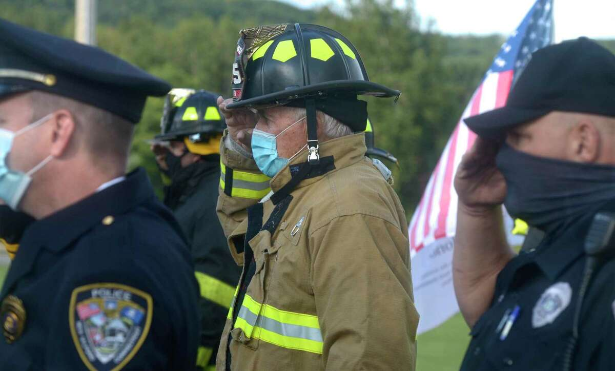 David Williamson, with the Gaylordsvill;e Volunteer Fire Department, stands at attention as New Milford marked the 19th anniversary of September 11, 2001, with its annual 9-11-01 Memorial Ceremony. Friday, September 11, 2020, in New Milford, Conn.