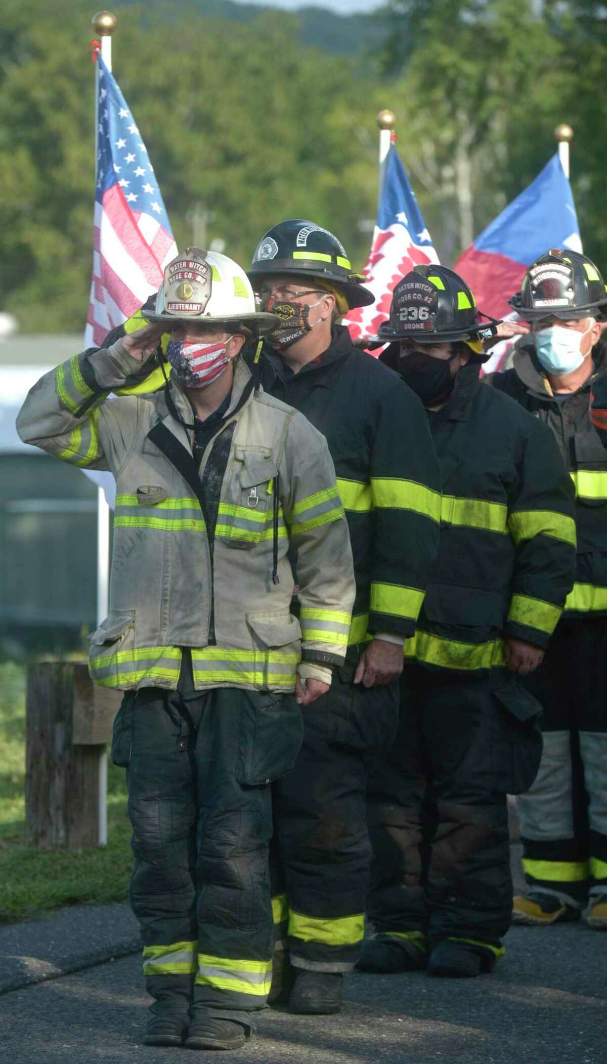 Members of the police and fire departments stand at attention as New Milford marked the 19th anniversary of September 11, 2001, with its annual 9-11-01 Memorial Ceremony. Friday, September 11, 2020, in New Milford, Conn.