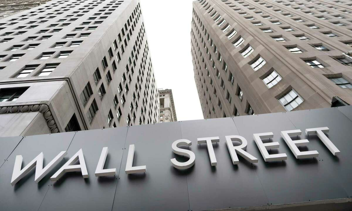 Buildings line Wall Street in New York.