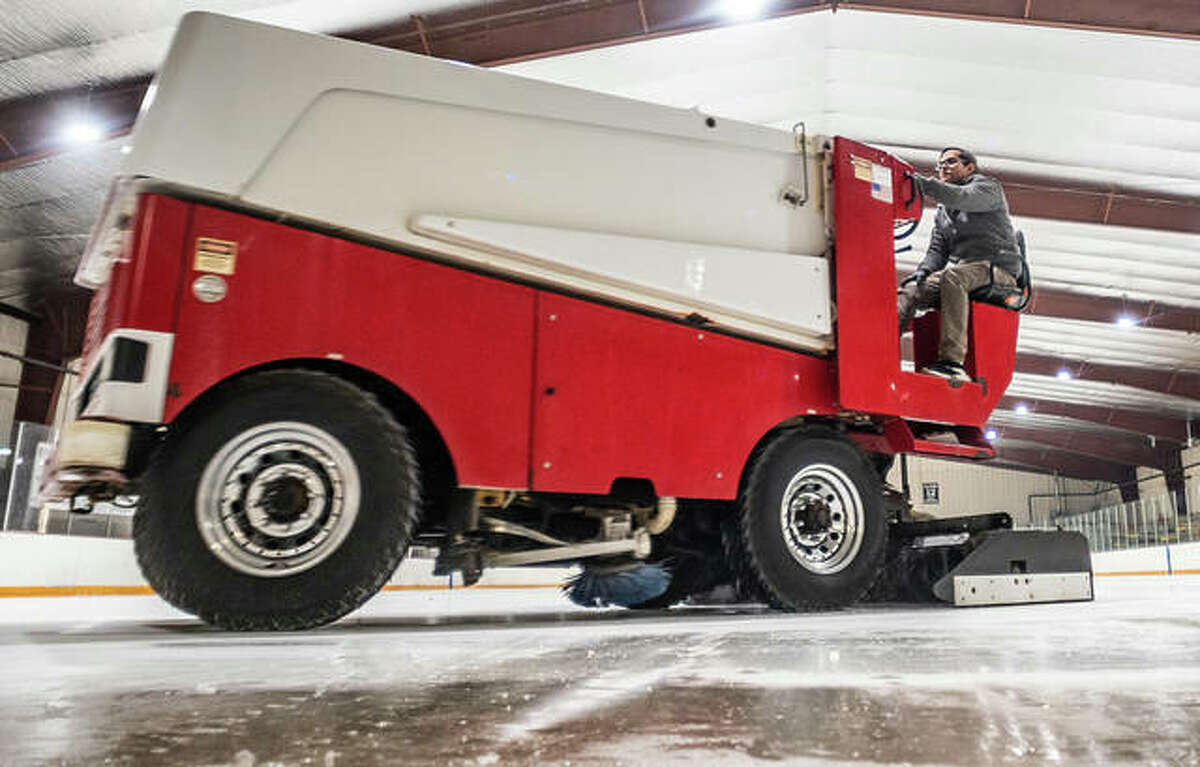 Scotty Miller drives a Zamboni machine at the East Alton Ice Arena. The rink's 25th birthday celebration, including the retiring of bonds used to construct it, is being tempered by the coronavirus pandemic.